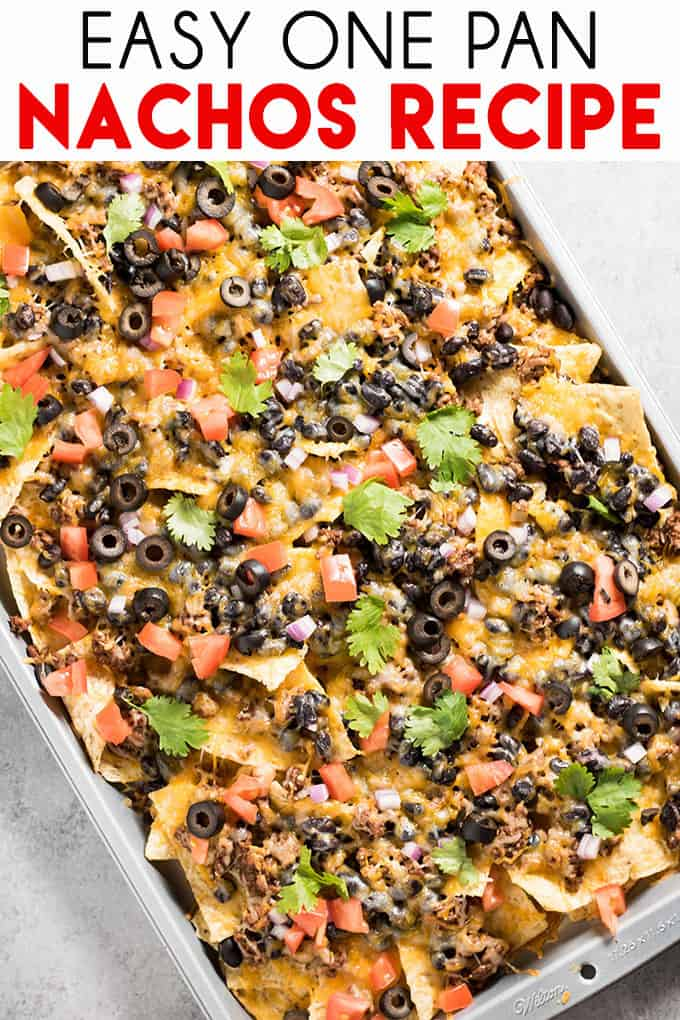 Easy Nachos are loaded up with beef, beans, cheese, and all of your favorite nacho ingredients! Baked in the oven for a simple dinner or appetizer! #nachos #thesaltymarshmallow