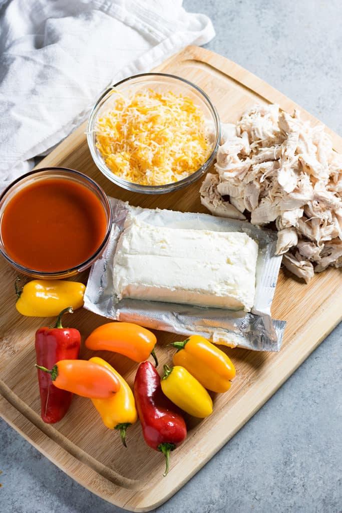 Cheesy buffalo chicken stuffed mini bell peppers