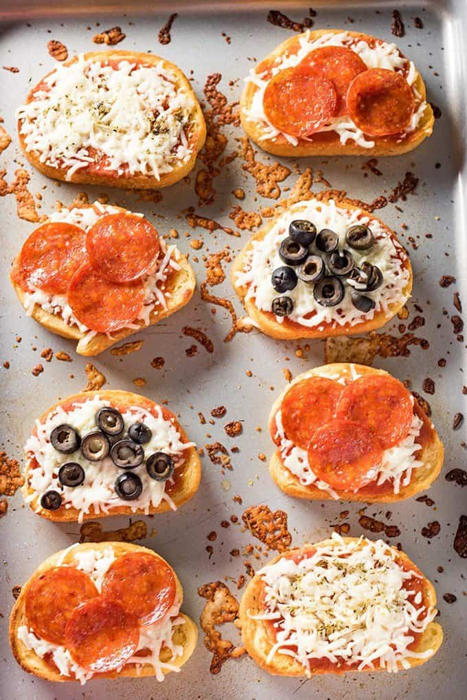 pizza toast made using frozen garlic bread with pizza sauce and toppings