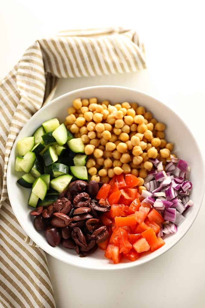 chickpea salad with cucumber olives tomato and onion