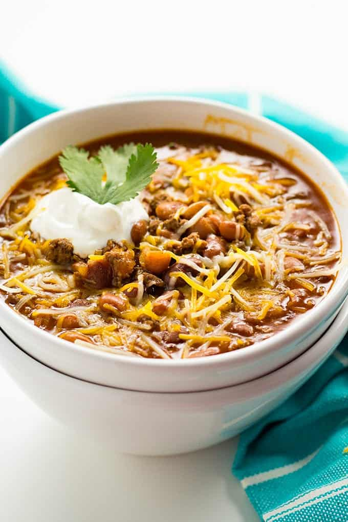 instant pot chili with canned beans topped with cheese and sour cream