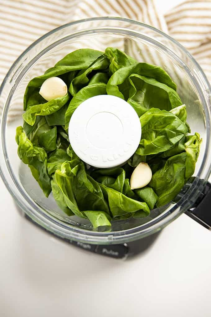basil and garlic in food processor for basil pesto