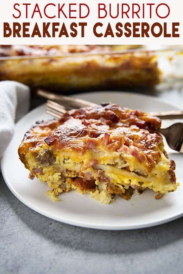 Stacked Tortilla Breakfast Casserole is a fun, easy, and cheesy casserole that can be made ahead!  Layers of tortillas are stacked with bacon, sausage, and ham for a mouthwatering brunch! #breakfast #brunch #breakfastcasserole #breakfastcasserolerecipe #thesaltymarshmallow