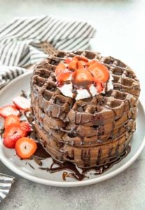 chocolate waffles stacked on a plate