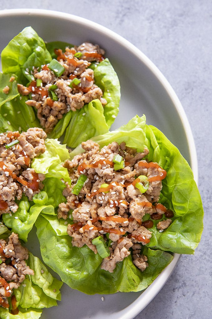 lettuce wraps with pork on a plate