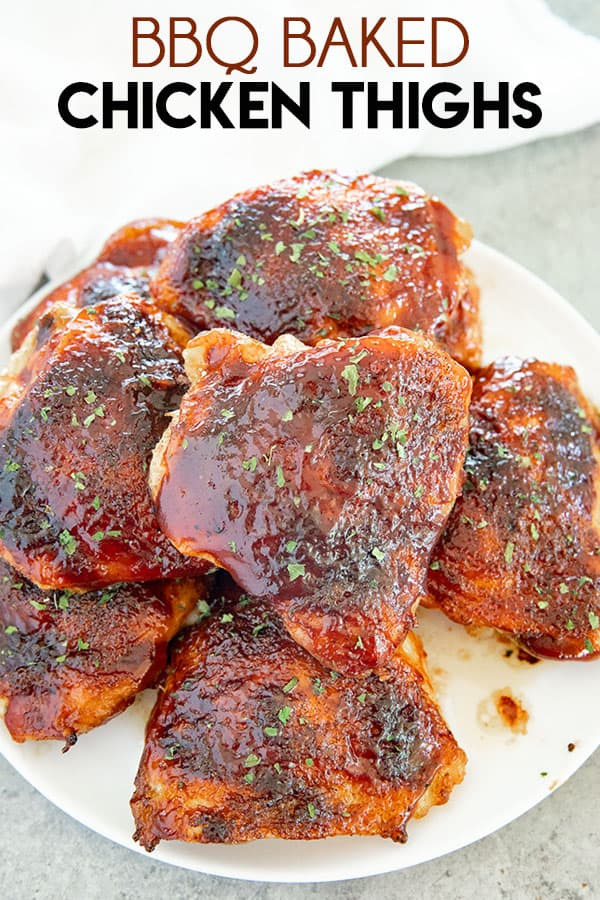BBQ Baked Chicken Thighs are made with a simple homemade bbq rub and basted in your favorite barbecue sauce! One of our favorite chicken thigh recipes they are so easy to make! #bbq #bbqchicken #chickenthighs #bakedchicken #bakedchickenthighs #chickendinnerrecipes