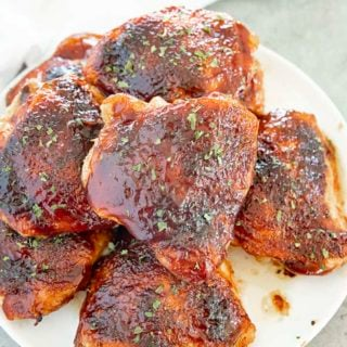bbq baked chicken thighs on a plate