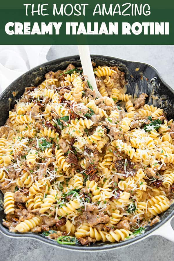 Amazing Creamy Italian Rotini is the best rotini recipe we've ever made! Full of Italian sausage, sun dried tomatoes, spinach and a mouthwatering garlic sauce!