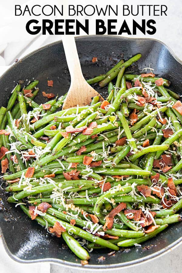 The Best Green Beans have so much flavor with an amazing bacon brown butter garlic sauce!  This green bean recipe is a perfect simple side dish!