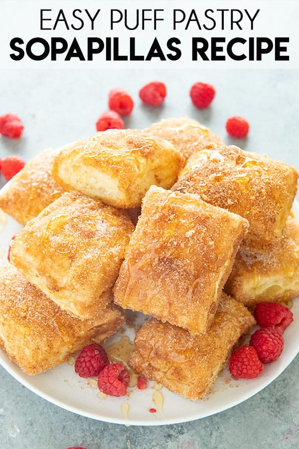 Easy Baked Sopapillas are light on the inside and crisp on the outside! Rolled in melted vanilla butter and cinnamon sugar these sopapillas are fun and mouthwatering! #sopapillas #dessert #easydessert