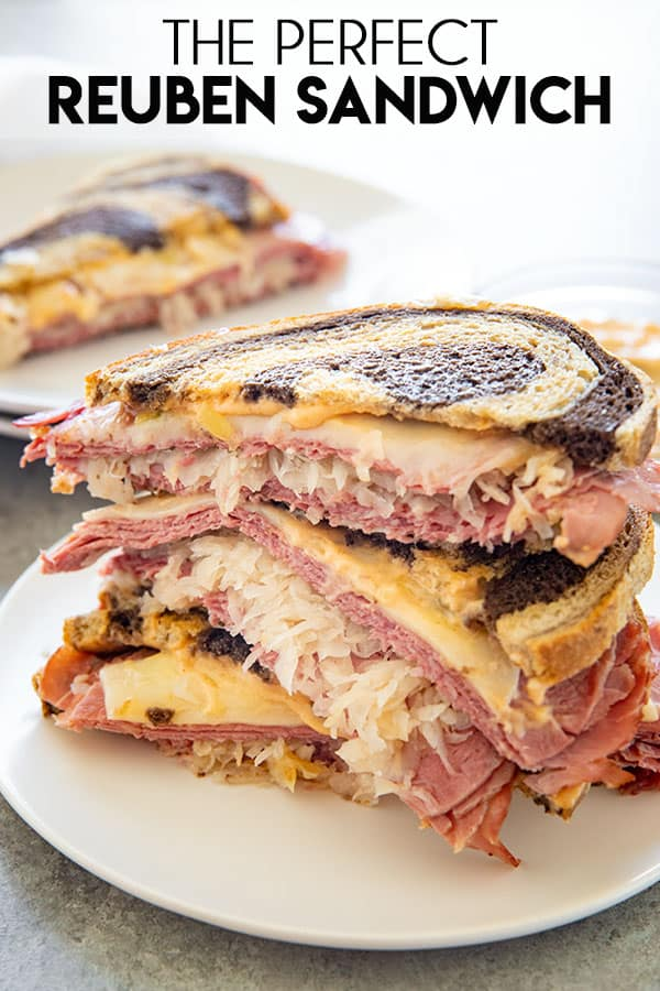 Perfect Reuben Sandwich is the absolute best, so tasty, and easy to make! This sandwich is packed full of corned beef, swiss, and a simple homemade dressing! #reuben #reubensandwich #cornedbeef #sandwichrecipes