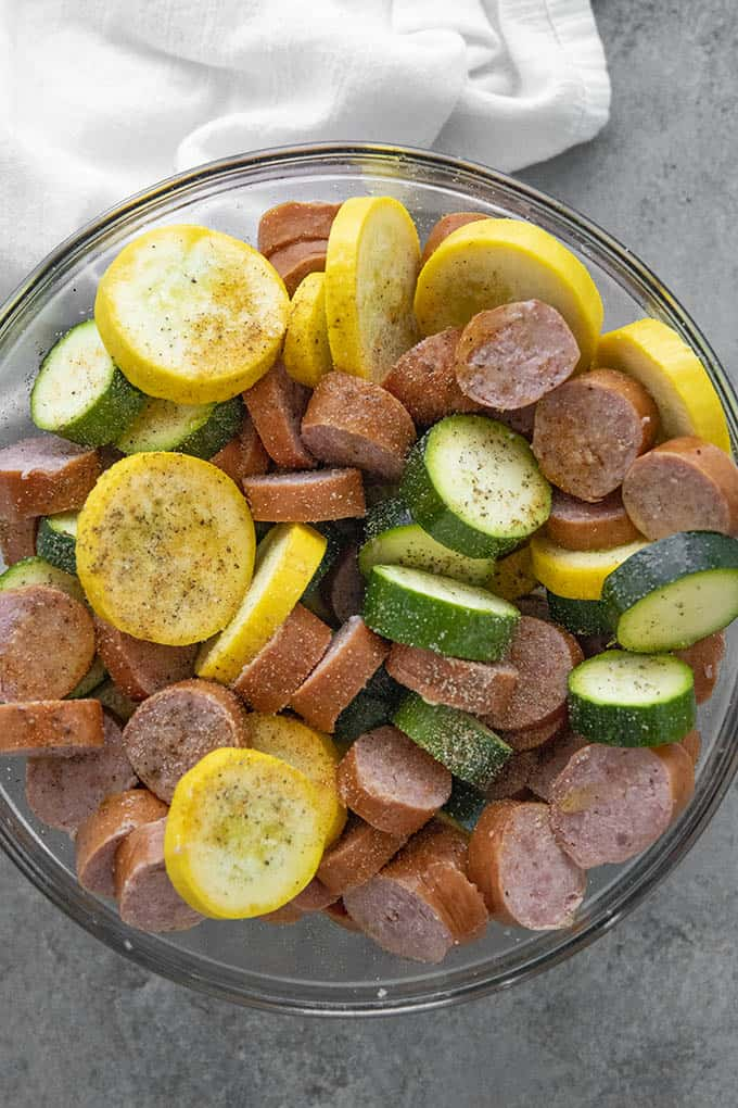 smoked sausage in a bowl with squash and zucchini