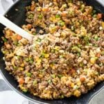 ground beef fried rice in a spoon