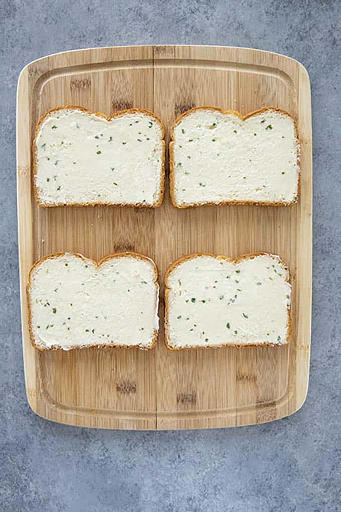 bread with garlic butter on cutting board