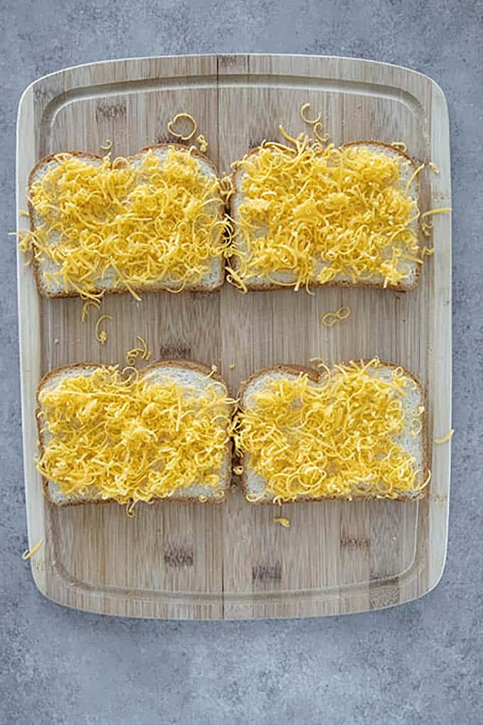 slices of bread topped with shredded cheese