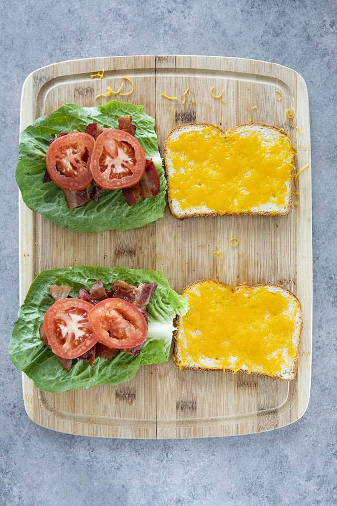 blt sandwich on cutting board