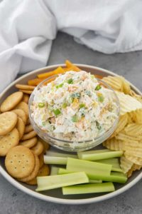 crab dip with crackers in a bowl