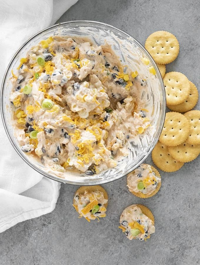fiesta ranch dip in a bowl with crackers