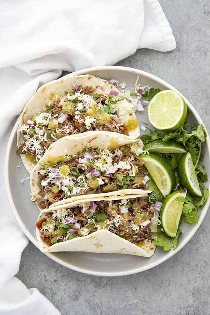 three beef machaca tacos on a plate