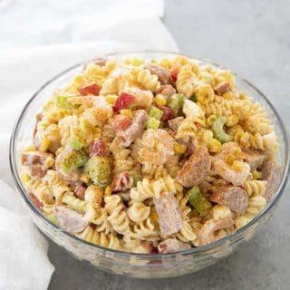 glass bowl full of shrimp boil pasta salad