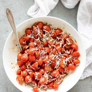 tomato salad with dressing and cheese in bowl