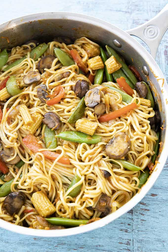 close up photo of lo mein in a stainless steel pan