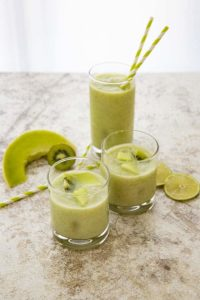 kiwi melon smoothie in three glasses