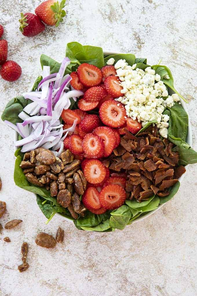 spinach salad with strawberries in a large bowl