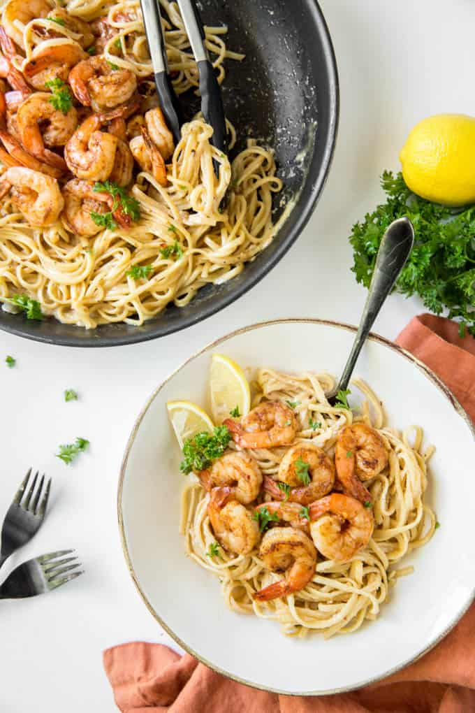 A large bowl of cajun shrimp pasta with a fork.