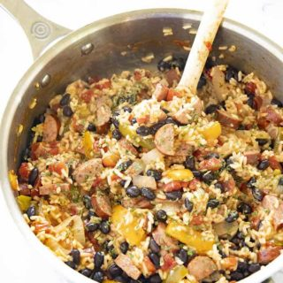 cajun rice and beans with sausage in a pan