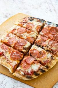 grilled pizza cut in slices