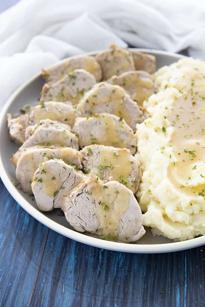 instant pot pork tenderloin and potatoes on a plate