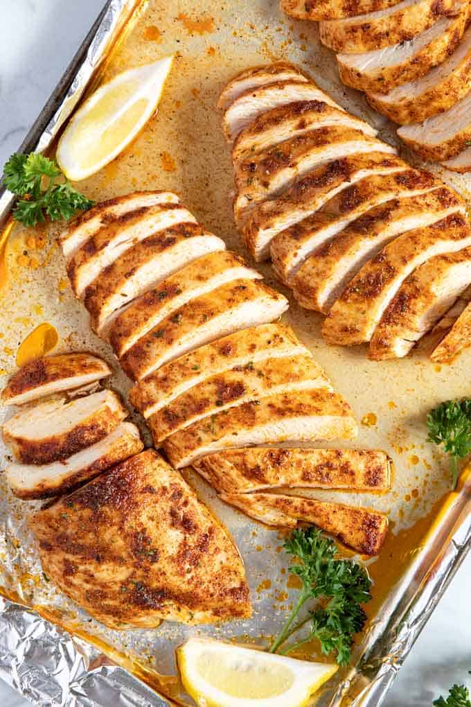 Oven baked chicken breast on a sheet pan.