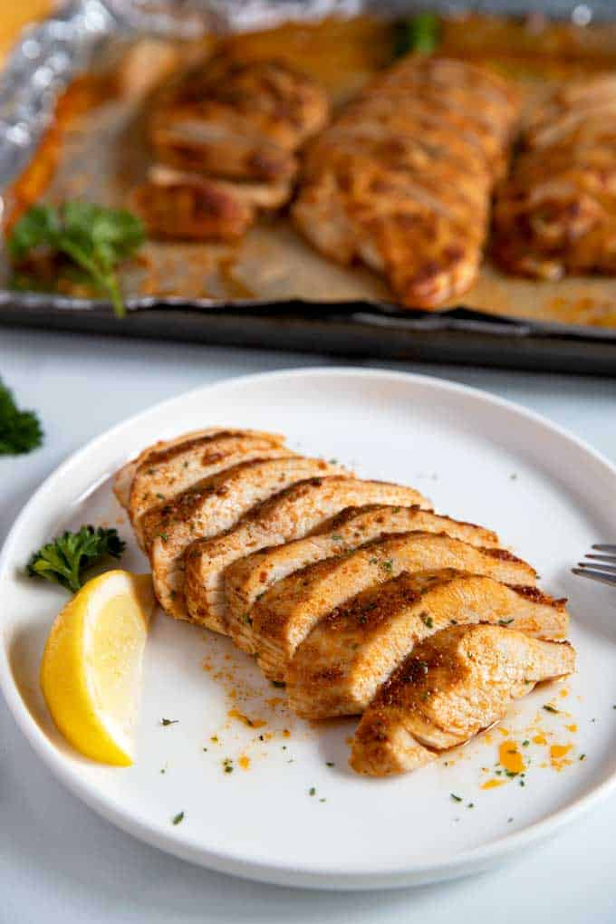 Sliced Baked Chicken Breast on a white plate