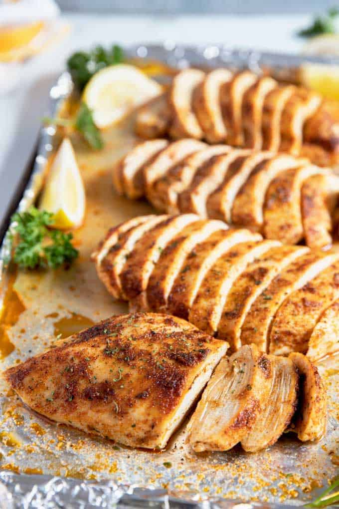 Baked Chicken Breast sliced on a baking sheet.