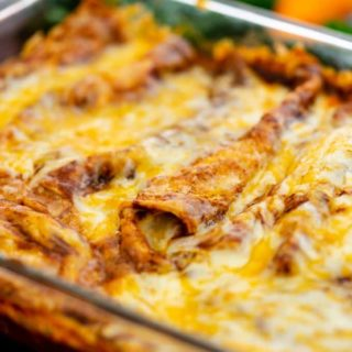 Baked Red Cheese Enchiladas in a glass dish