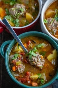 albondigas soup with three bowls and a spoon