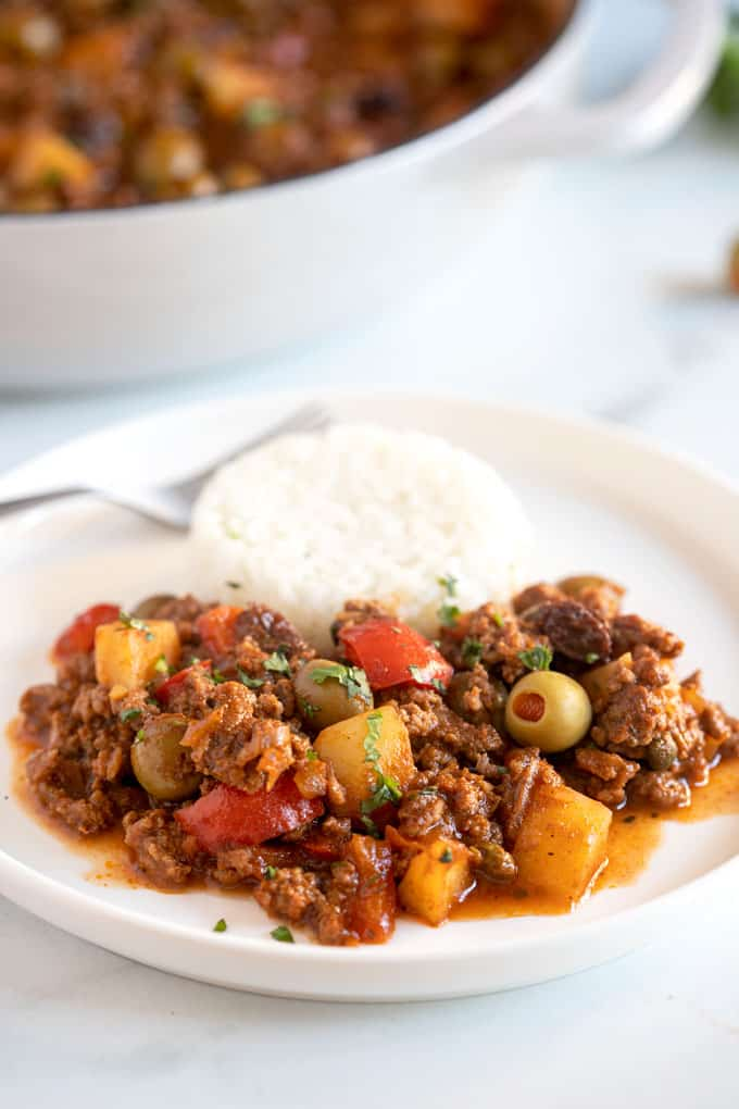 A plate of picadillo served with white rice
