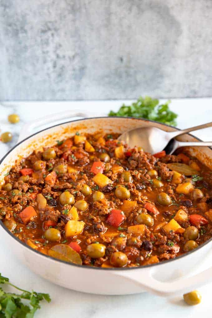 Cuban style picadillo in a ceramic skillet