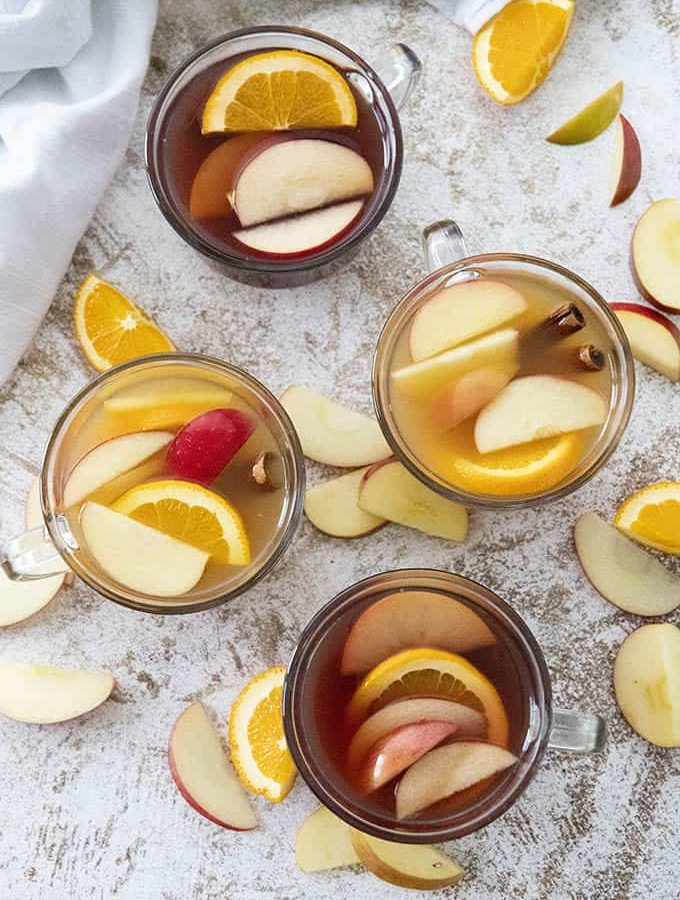 apple cider cocktail in four glasses