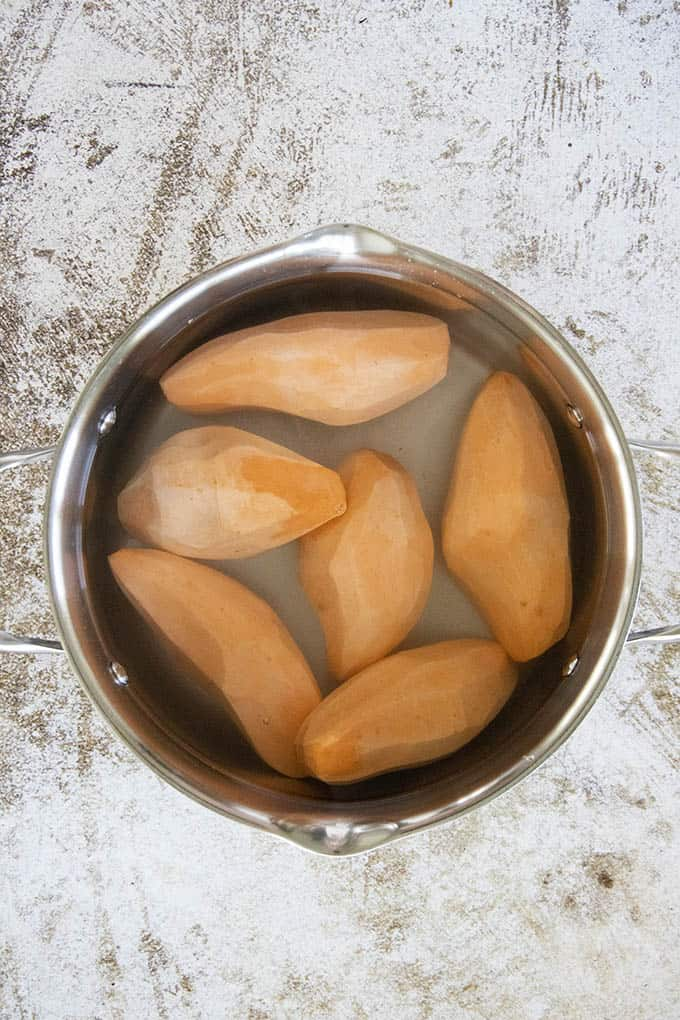sweet potatoes in a pot of water