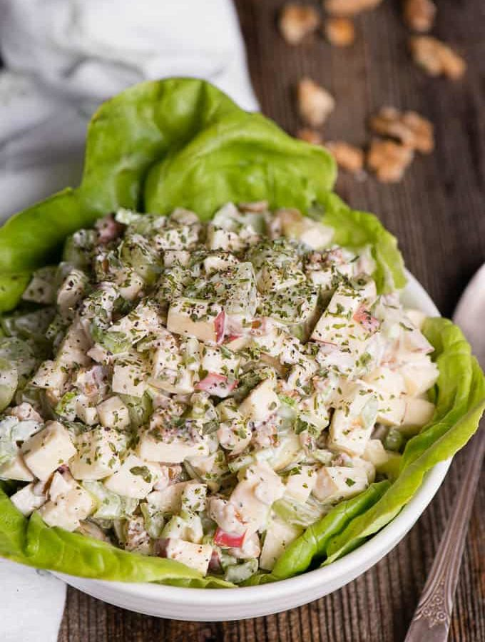 bowl of waldorf salad on lettuce in bowl