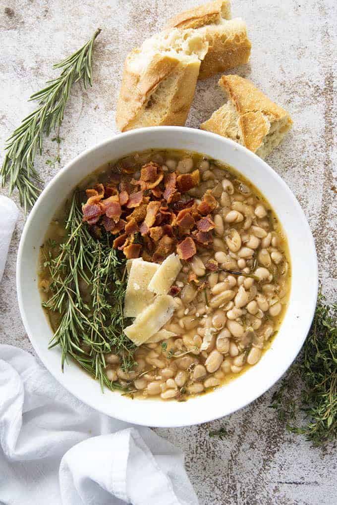white bean soup with bacon in bowl