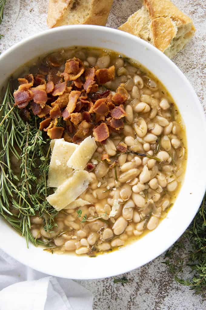 photo of white bean soup topped with bacon