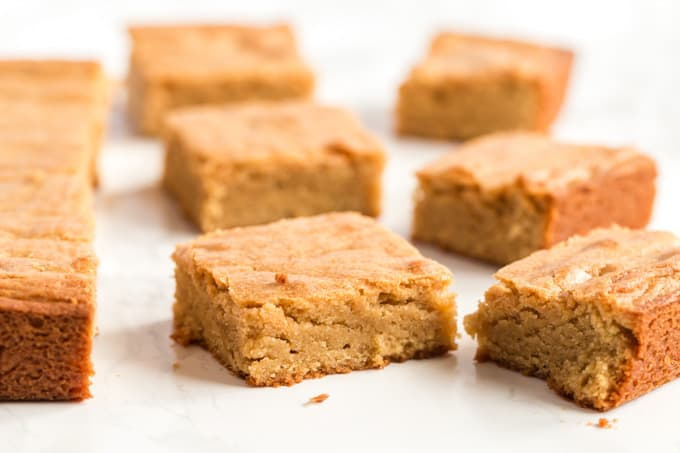 blondies cut and set on parchment paper