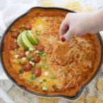 chicken enchilada dip on chip