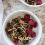 baked oatmeal in a bowl with berries