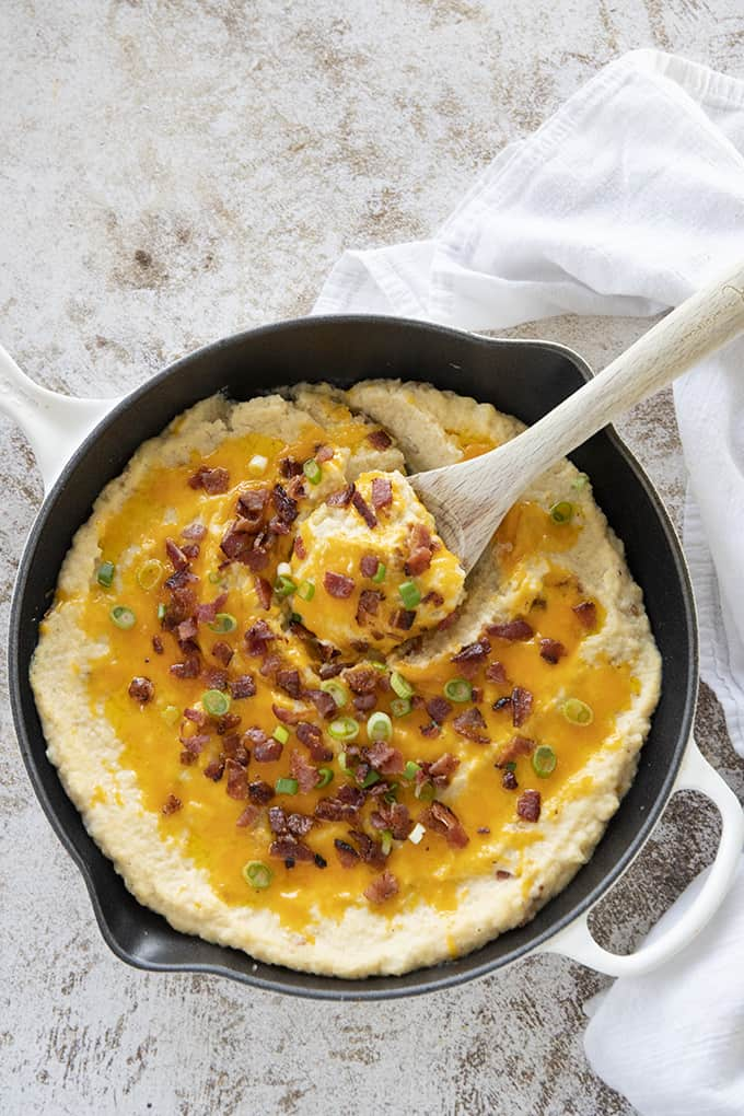 cauliflower casserole in dish with spoon