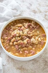 ham and bean soup in a white bowl