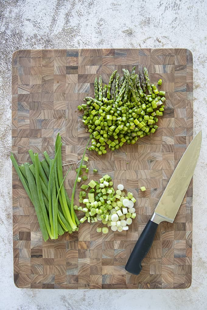 asparagus and green onion on cutting board